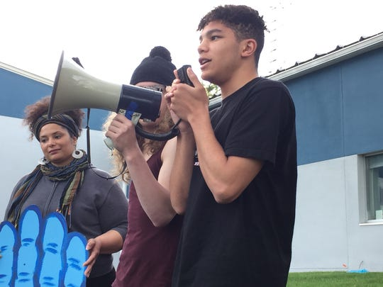 South Burlington student Isaiah Hines, who suggested to the school district that it drop the Rebel nickname, speaks Wednesday evening at a rally outside South Burlington City Hall.
