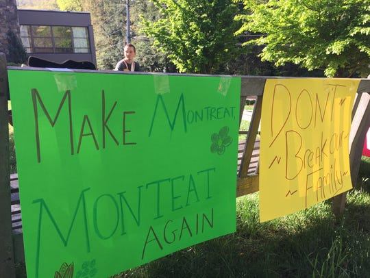 Signs hang on a bench Wednesday on the campus of Montreat