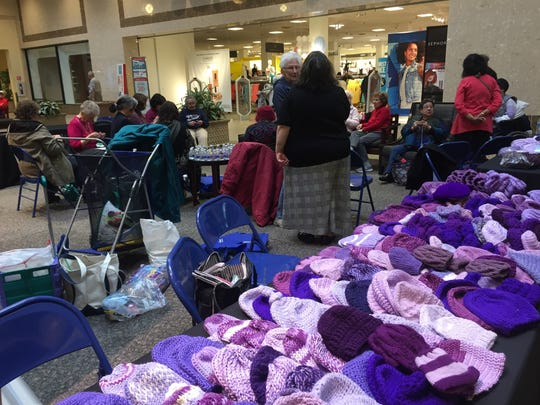 At the Brunswick Square mall on last year, knitters and crocheters sat around a big circle in the J.C. Penny court, with tables of baby hats and free purple yarn nearby. We'll be doing it again on April 10.