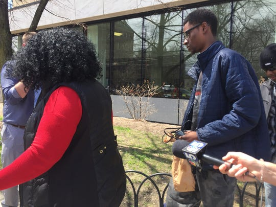 Josiah Leach, right, leaves the federal courthouse in Burlington  with his mother, Joy McKenzie, Thursday, April 27, 2017, after a detention hearing.
