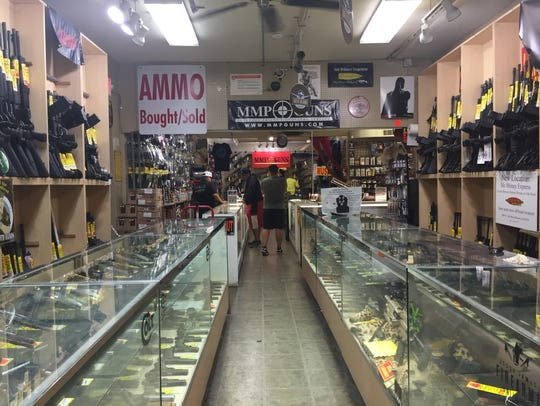 Firearms section at Mo Money Pawn Shop near 12th Street