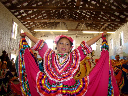 One of several dancers from St. Francis de Paula Folklorico from Tularosa is shown inside of one of two buildings housing Carrizozo Heritage Museum. The museum was also the site of presentations throughout the day.