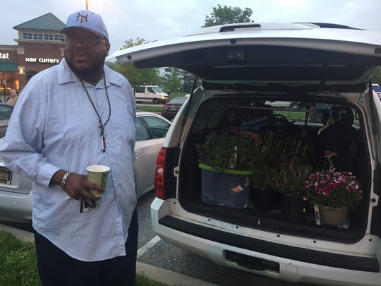 Joe Cobb, who was ready to plant flowers he'd purchased Wednesday, spent the night in the Dove Run Shopping Center when police would not let him return to his home in Brick Mill Farm.