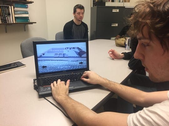 Dakota Hallinin, a Purdue senior, tests the graphics of a gaming program used to map out what Fort Ouiatenon, an 18th century trading post along the Wabash River, might have looked like. The senior project is the beginning of work that will be used as an interpretation tool for Tippecanoe County Historical Society and its annual Feast of the Hunters' Moon.