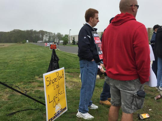Workers protest in Freehold Township on Monday after