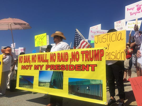 Nearly 100 demonstrators spoke out against deportations and separating families during an immigration rally in Indio on Monday May 1, 2017.