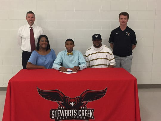 Stewarts Creek basketball standout Desmond Sales recently signed with Bryan college. Pictured in the front row (l-r) are Jennifer Sales (mother), Desmond Sales and Felix Sales (father). In the back row (l-r) are SCHS Head Coach Kris Hooper and Bryan Head Coach Don Rekoske.