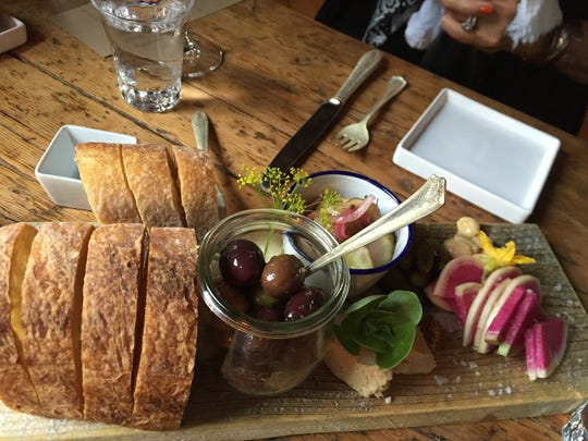 Bread, olives and other pre-dinner nibbles served at