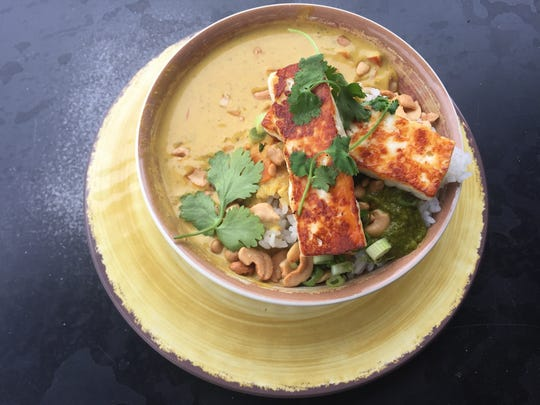 Griddled paneer cheese over rice with coconut curry,