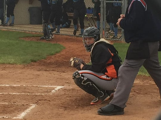 Gibsonburg's Allie Teeple looks to the dugout Tuesday against visiting Danbury. Teeple and the Golden Bears have fun during games.