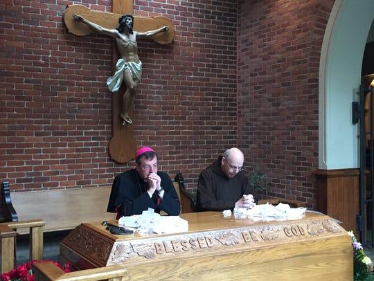 Catholic Archbishop of Detroit Allen Vigneron prays