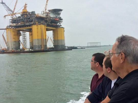 Members of Corpus Christi's government and business community watched the final stages of the Stampede tension-leg platform's construction during a recent tour of the Port of Corpus Christi. The Hess Corp. will use the platform as part of its offshore operations off the Louisiana coast.