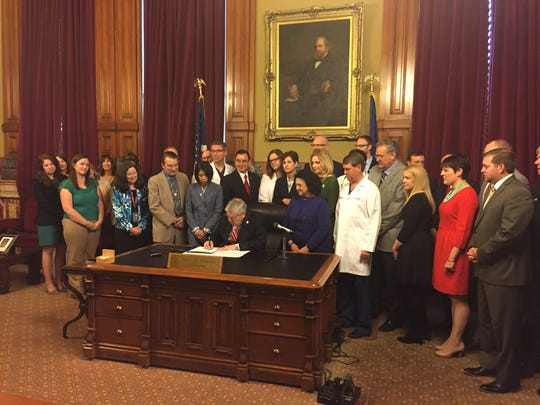 Gov. Terry Branstad signs into law a bill Friday, May 5, 2017, limiting medical malpractice lawsuits.