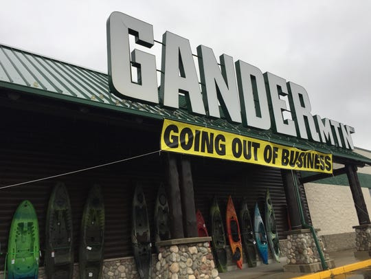 "A ""Going Out of Business"" sign hangs outside the Gander"