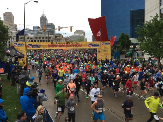 Runners set off for the 41st running of the OneAmerica 500 Festival Mini-Marathon and 5K in Downtown Indianapolis on Saturday, May 6, 2016.
