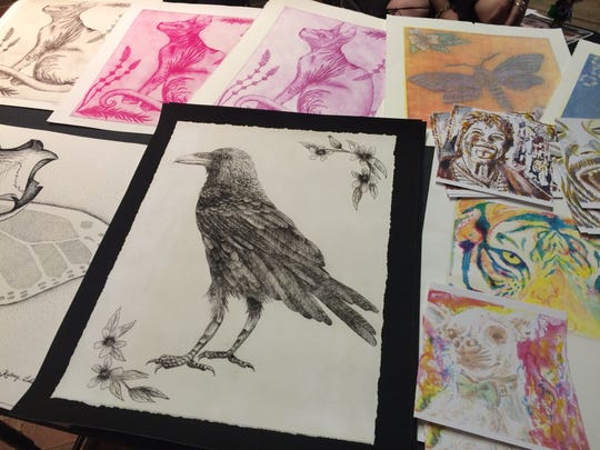 Kelsey Tidwell sold her ink drawings at the Downtown Farmers Market during the May After Hours Artwalk. Booth space is free at the event because organizers say they don't want anything to hinder an artist from coming out to the event.