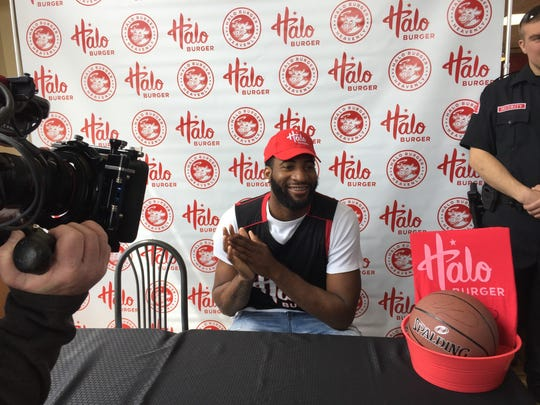 Pistons center Andre Drummond poses for photographs with fans at an event in Fenton to celebrate the launch of his signature burger at Halo Burger on May 6, 2017.