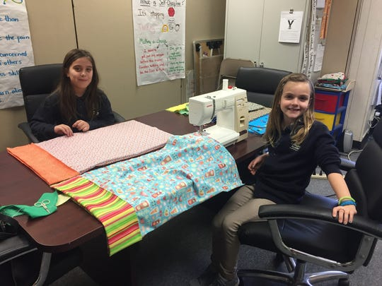 Compass Academy Charter School third graders showed support for cancer patients by making pillowcases and writing letters.