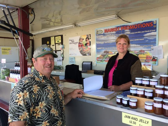 Brad Gray, manager of Greater Springfield Farmers Market, and Writa Gray, his wife, staffed their market trailer on Saturday, May 6, 2017.