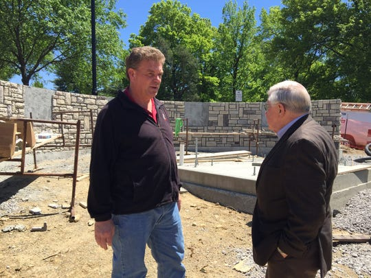 Village of Evendale Service Director/Engineer James Jeffers and Mayor Richard Finan talk over final details for the village's new memorial honoring veterans, police and firefighters.