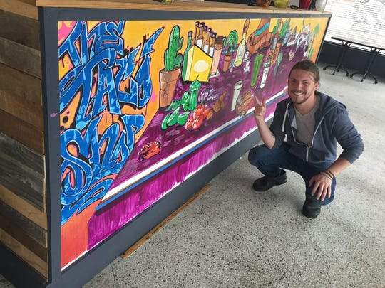 Chef Evan Slusher shows off new murals at The Taco