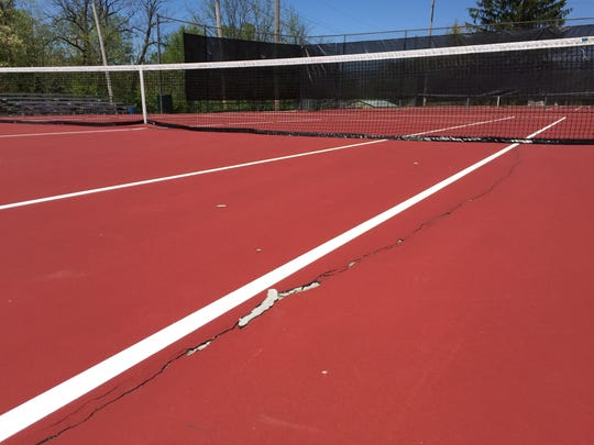 The tennis courts at Glen Miller Park were resurfaced last fall at a cost of $30,000, but they already have developed new cracks.