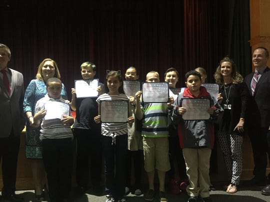 Winslow Elementary School students were commended for leading the flag salute at Wednesday's  school board meeting.