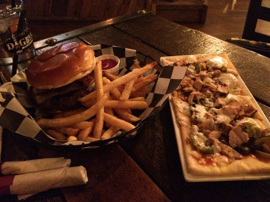 Among the menu options at Digby's Pub and Patio are the classic burger (left) and the buffalo chicken pizza.