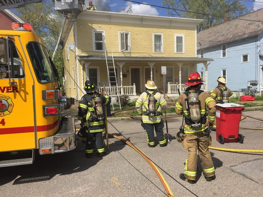 Firefighters battle a blaze at a duplex at 35 Platt St. in Winooski on Friday afternoon, May 12, 2017, that left the residence uninhabitable.