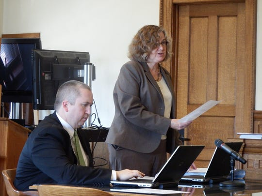 Johnson County Attorney Janet Lyness speaks at the sentencing of Justin Marshall Friday at the Johnson County Courthouse as Assistant County Attorney Jude Pannell looks on.