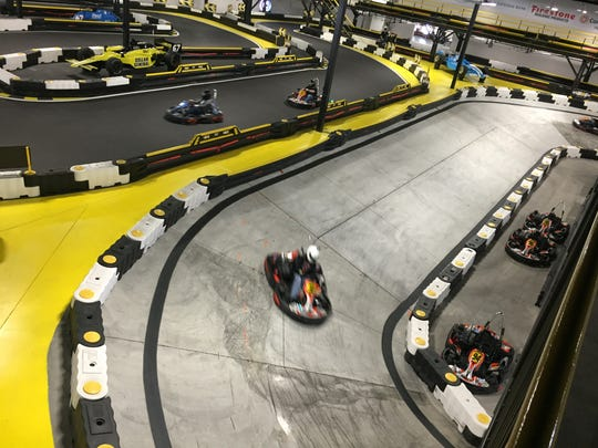 Rookie and pro racers play on the oval at Speedway Indoor Karting, below 1911 Grill, 1067 N. Main St., Speedway.