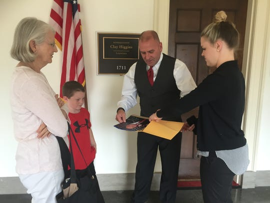 Rep. Clay Higgins, R-La., and a staffer chat with constituents earlier this month outside his office in Washington, D.C.