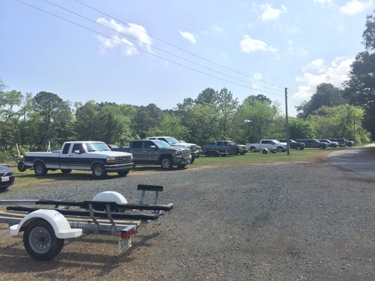 A row of pickup trucks and boat trailers, many from outside Virginia, were parked at the Folly Creek public boat ramp in Accomack County, Virginia on Friday, April 29, 2017.