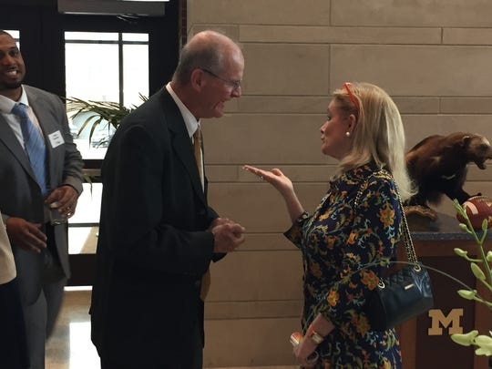 Jack Harbaugh talks with congresswoman Debbie Dingell