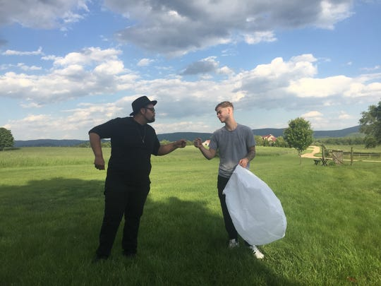 "Matt Johnson, of Fishersville, thanks his friend Clay ""Boo"" Agee, of Waynesboro, with a fist bump for directing him in a music video on Sunday, May 14, 2017. Now living in Atlanta, Agee, drove up over Mother's Day weekend to help Johnson with the project."