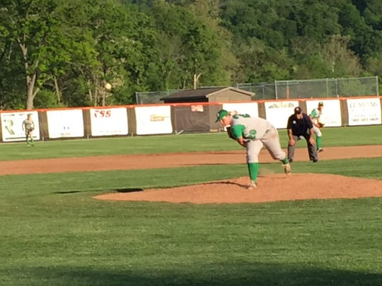 Newark Catholic senior Drew Young delivers to the plate