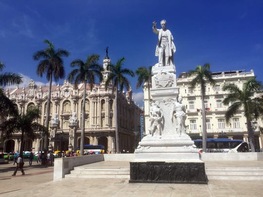 A statue looks over a square in front of Havana's Gran
