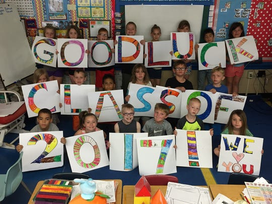 One of Tiffin Elementary's first-grade classes created a message of support for the graduates who would be walking their halls.