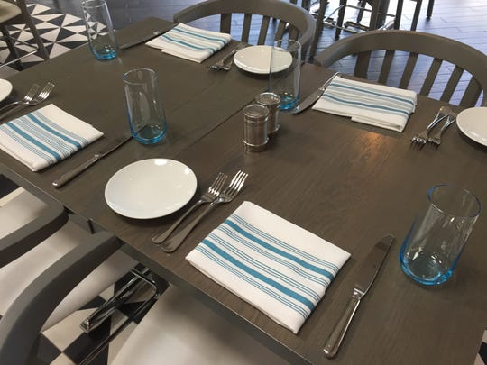 Table settings at the Shore Room restaurant feature cool blues.