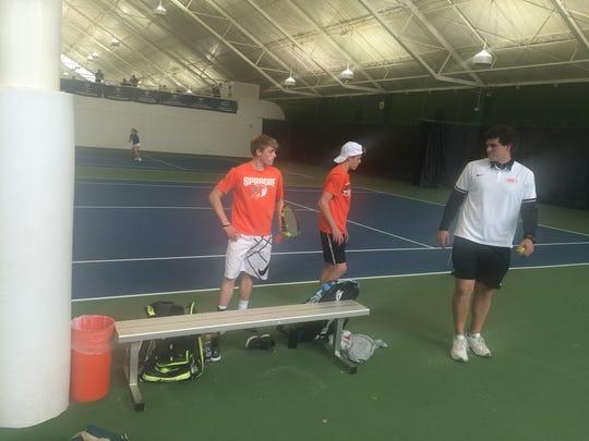 Logan and Judd Blair talk with Sprague coach Uriah Jones on Thursday at the OSAA Class 6A tennis state tournament.