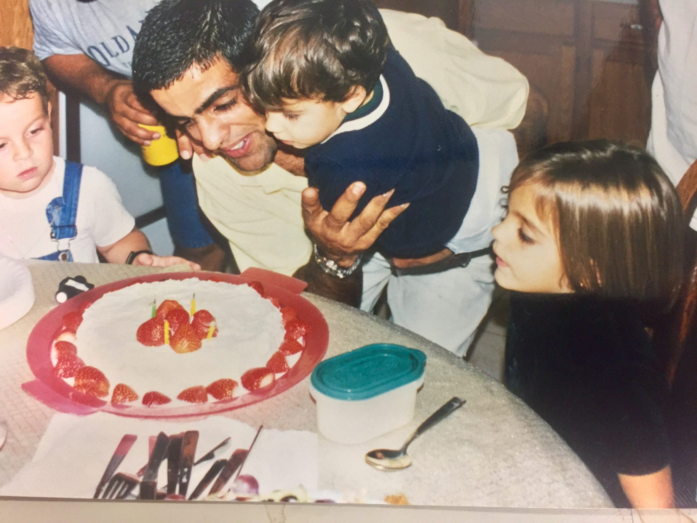 Rudy Blanco celebrates his birthday while holding his son Noah. His daughter Hannah is on the right.
