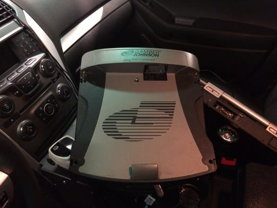 A Gamber-Johnson computer mount sits inside a Plover police squad car.