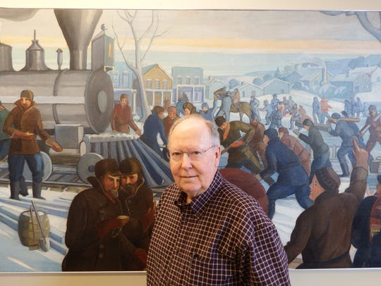 J. Patrick White stands in front of Mildred Pelzer's