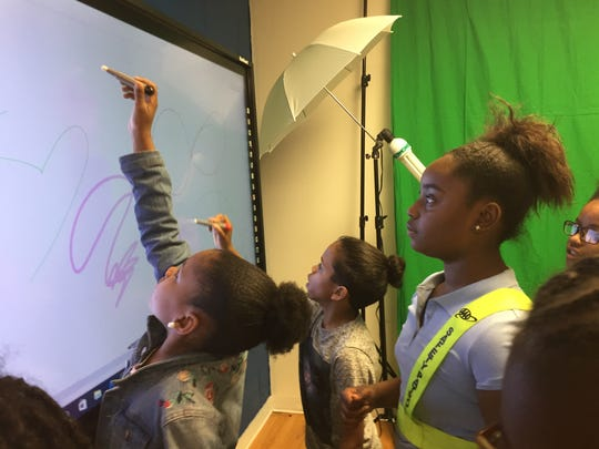 Students check out the smart board at the new innovation lab.