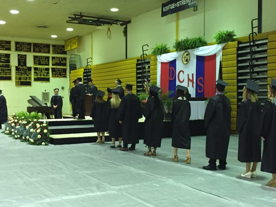 Delone Catholic seniors walk across the stage and receive their high school diplomas.