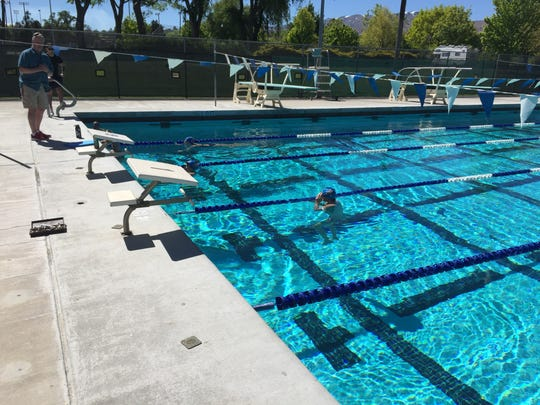 Reno swim coach Pete Schouweiler talks to the swim team Thursday at Idlewild pool.