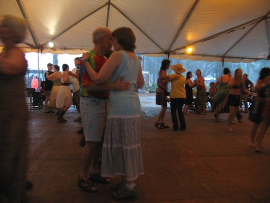 Dancing during a rainstorm at the 2010 festival.