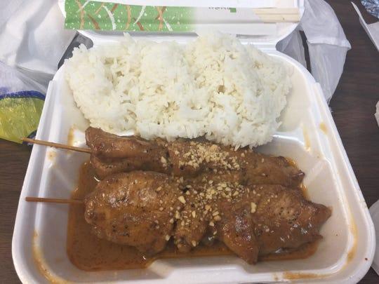 Chicken satay and fresh steamed rice from International Market & Restaurant