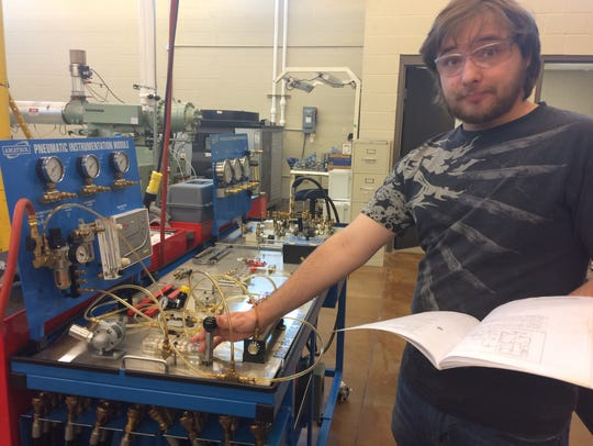 Taylor Stutts operating a pneumatic instrumental module