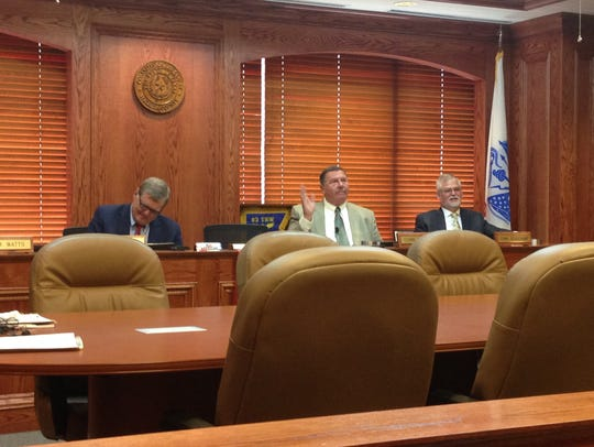 Wichita County Commissioners Mark Beauchamp, right,